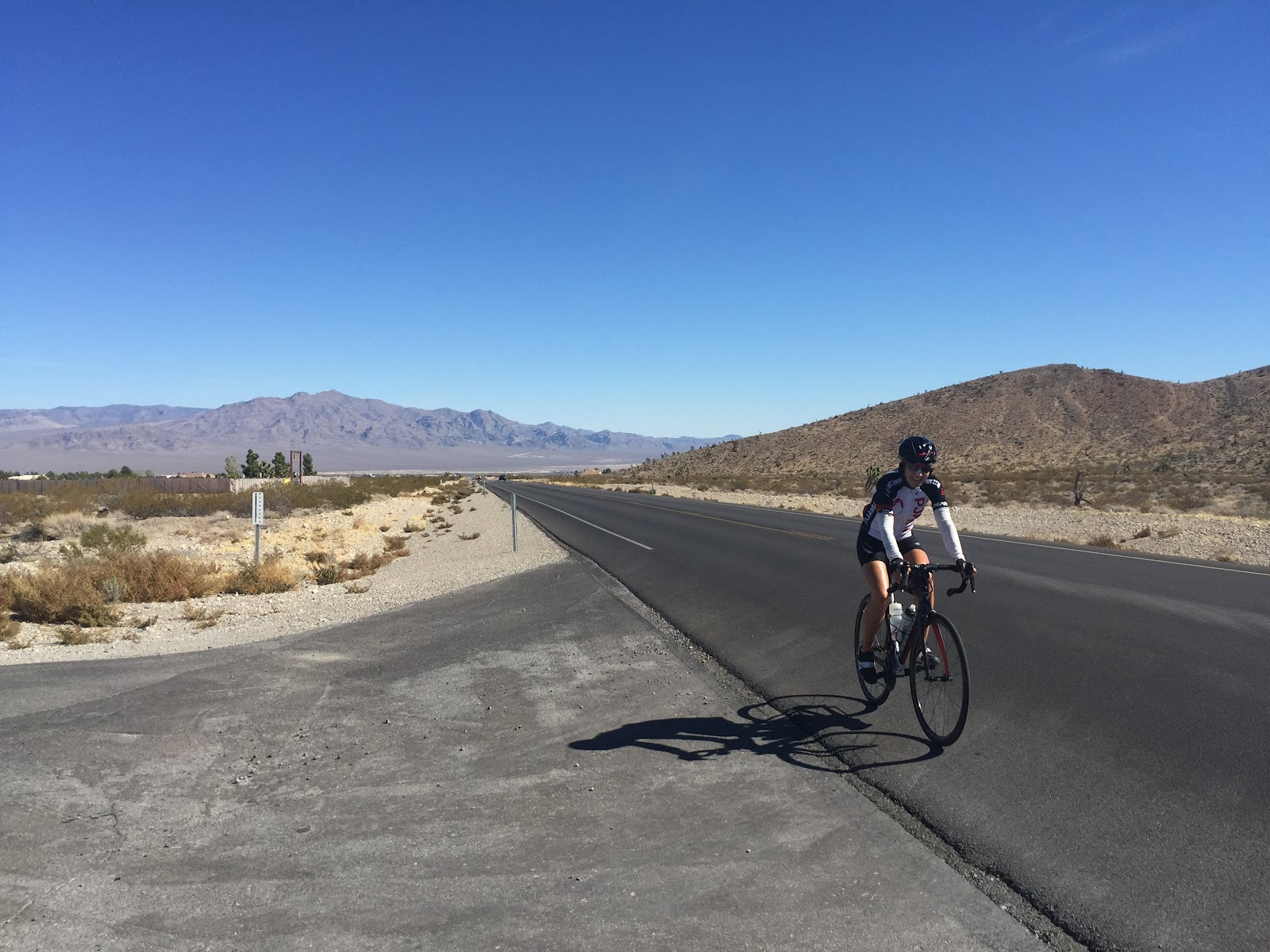 Cyclist riding bike up Kyle Canyon, Hwy 157, to Mt. Charleston.