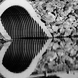 Rocky Heart by Jeff Galbraith - Black & White Landscapes ( culvert, rocks, reflection, river, water )