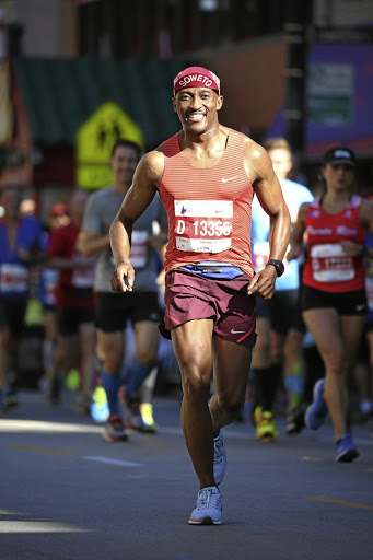Coach Peteni, running  here in the Chicago marathon,  advises that training should be fun - mostly.