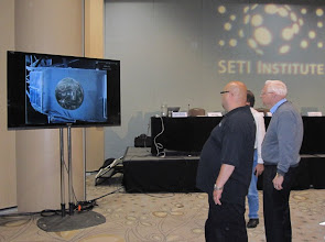 Photo: Frank Drake with the Audio-Visual support chaps, setting up his slide show before their panel.  Hey look, the Voyager Golden Record he developed with Carl Sagan!! :)