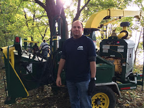 Photo: John with the wood chipper that broke down when it tried to chip wood (how much wood could a wood chipper chip if a wood chipper could chip wood?)