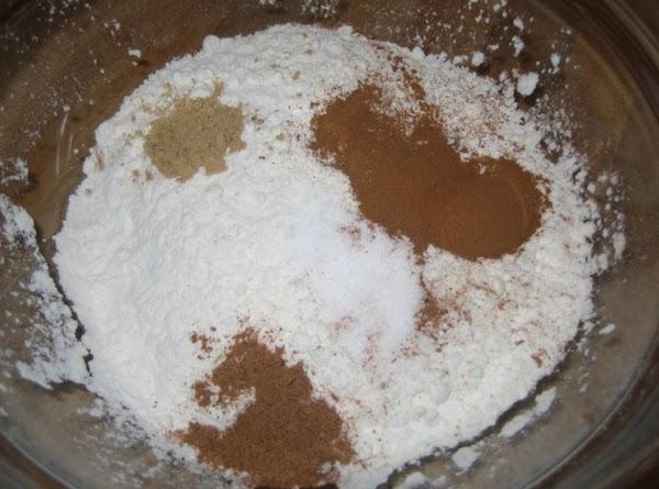 In a separate bowl combine flour, salt, baking soda, cinammon, ginger & nutmeg. Stir...