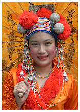 Photo: Orange Vision  Taken during the annual Chiang Mai Flower Festival (held 1st weekend of February). I had to wander out into the parade itself to get this girls photograph. Fortunately for me she stopped and smiled letting me take a much wider shot that the final image you see here. No colour alteration. Only a slight bit of cleaning up plus image cropping involved.