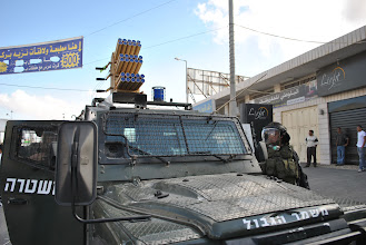 Photo: I don't know what that is atop this Israeli military vehicle but it looks dangerous.