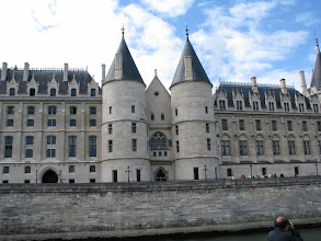 """Photo: Conciergerie (""""the keeper"""", on the left) of the Charles V palace which he ceased to use in the 14th century and where he placed his law courts. The right part is the Court of Cassation."""