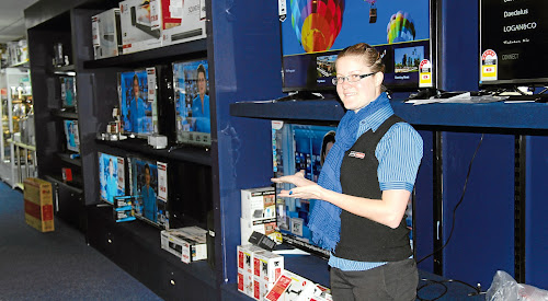 Leading Appliances staff member Sami Dearden showing off some televisions which would be perfect for watching the Origin series on