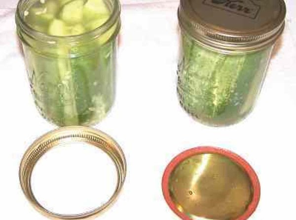 PACK spears into jars.    Ladle hot pickling liquid over spears leaving...