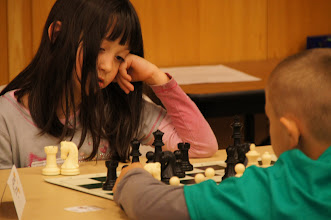 Photo: A sleepy Ella Flett calculates her response to Ethan's knight move.