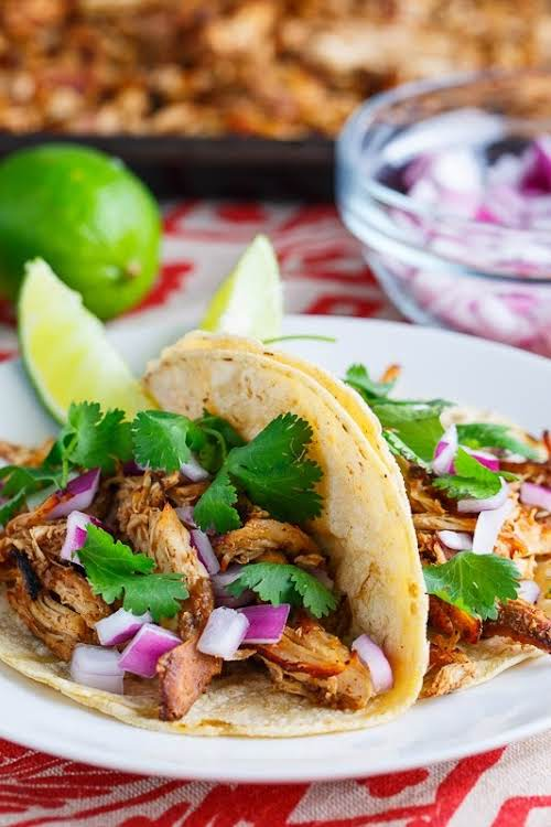 "Slow Cooker Chicken Carnitas Tacos""A lighter version of carnitas using chicken that..."
