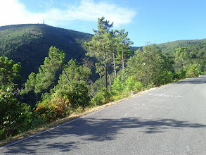 """Photo: View of a radio mast on top of Monte Serra. Bicycle racers' names painted on the road by fans. Think I saw """"Contador"""" in very faded paint at one place."""