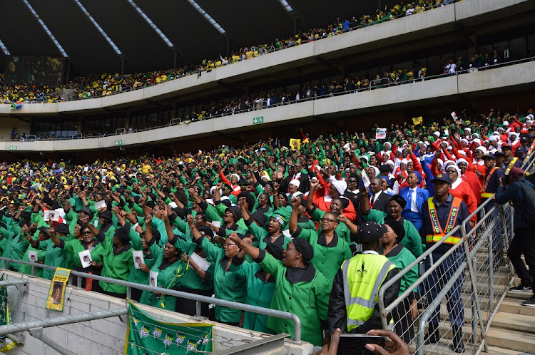 Mourners attend the funeral service of late struggle stalwart Winnie Madikizela-Mandela at Orlando Stadium in Soweto.