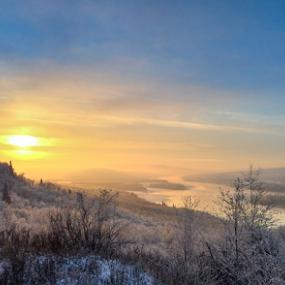 Prairie Valley Sunset by Charles Adam - Landscapes Sunsets & Sunrises ( clouds, pines, hills, frost, frozen, dusk, sun, island, hillside, winter, cold, sunset, snow, bush, evening, river )