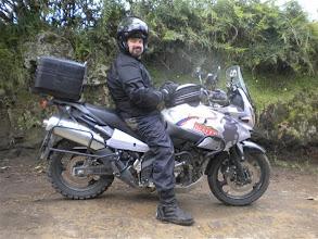 Photo: Brian, enjoying his rental bike in Ecuador. That metal plate, under the bike, got a lot of use!