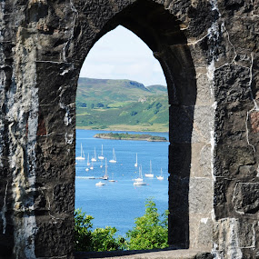 View from a window by My 1st Impressions - Landscapes Travel ( arch, window, blue, boats, sea, oban )