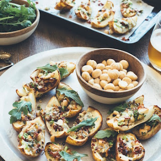 Roasted Potato Skins With Macadamias, Bacon, Rocket And Blue Cheese.