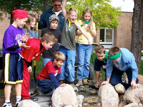 Photo: Acorn Ponds & Waterfalls, Certified Aquascape Contractor since 2004. Check out our website www.acornponds.com and give us a call 585.442.6373.  Tom Warmerdam of Acorn Ponds & Waterfalls works with parents, teachers and children at Northside School in Monroe County, Fairport NY installing an Ecosystem Water Garden Sustainable Pond. What better way to engage kids in learning than to have a sustainable pond with complete learning environment?  To see more photos of this Pond Construction project, please click here: www.facebook.com/media/set/?set=a.487266561310471.97639.103109283059536&type=1  To learn more about Pond Installations, please click here: www.acornponds.com/ponds.html  Check out our photo albums on Pinterest here: www.pinterest.com/acornlandscape/  Click here for a free Magazine all about Ponds and Water Features: http://flip.it/gsrNN  Contact Acorn Ponds & Waterfalls now! 585.442.6373 or please click here: www.acornponds.com/contact-us.html