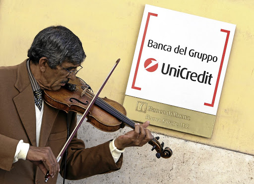 Turnaround plan:: A basker plays a violin outside a branch of UniCredit bank in Rome. CEO Jean Pierre Mustier plans to start the rights offer before March 10 and shareholders will be asked to approve the conversion of every 10 shares into one new share. Picture: REUTERS