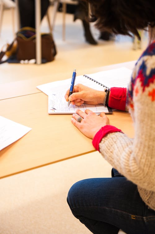 Picture of woman writing