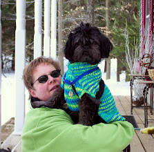 Photo: Joanie holding Sampson in his winter finest.