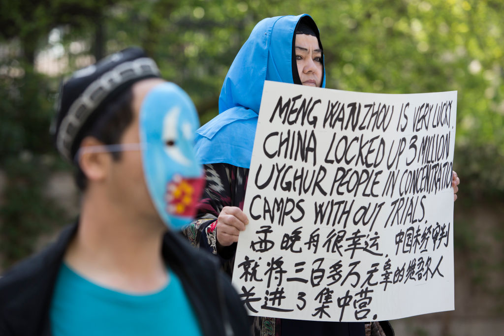 Protestors raise awareness about China's treatment of Uyghurs outside a court appearance for Huawei Chief Financial Officer, Meng Wanzhou at British Columbia Supreme Court in Vancouver, on May 8, 2019