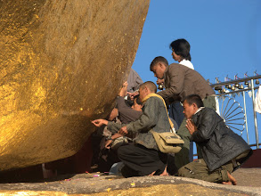 Photo: Putting golden leaves on the Golden rock