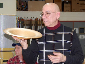 Photo: Mike Colella talks about his oak bowl that he turned wet to allow it to move.