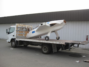 Photo: Fuselage on the flatbed truck.  We used two ramps to get it on to the lift gate, which was raised about halfway.
