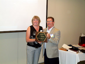 Photo: Darryl Somers (RVC RP) awarded the Hayward Murray Region II award for RP, to Christine Kemp of Ottawa Valley Chapter