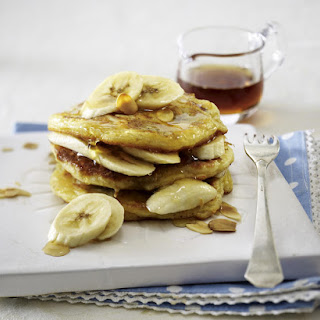 Banana Pancakes with Maple Syrup and Almonds.