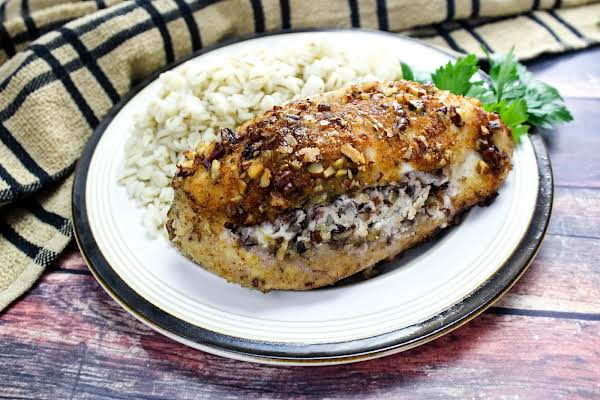 Cherry Pecan Stuffed Chicken Breast On A Plate.