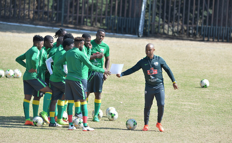 Bafana Bafana assistant coach Thabo Senong and players during the South African national soccer team training session at Marks Park Training Grounds on August 08, 2017 in Johannesburg, South Africa.