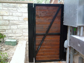 Photo: Custom gate, inside view. Mounted on a steel frame.