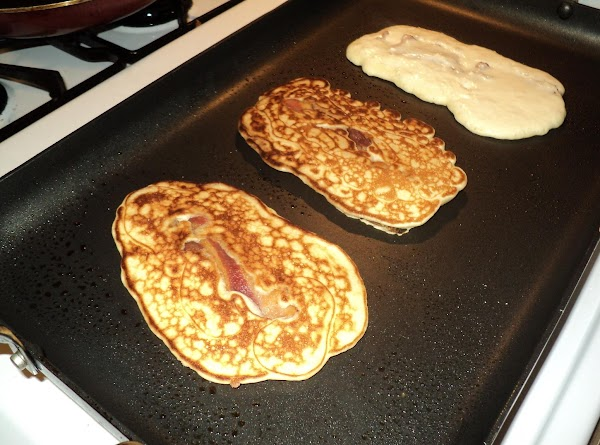 Lay precooked bacon strip on electric griddle or frypan..that has been sprayed with pam...