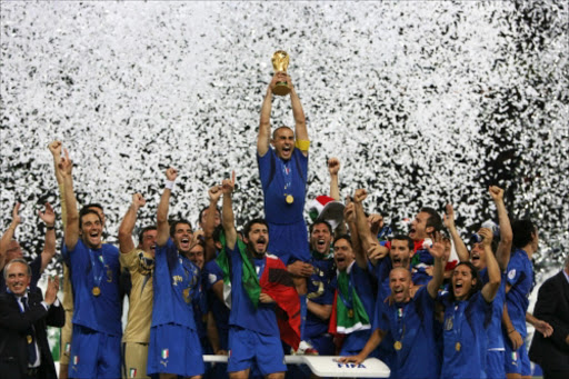 PICTURES OF THE YEAR 2006 Italy's Fabio Cannavaro (C) lifts the World Cup Trophy as he celebrates with team mates after the World Cup 2006 final soccer match between Italy and France in Berlin July 9, 2006. FIFA RESTRICTION - NO MOBILE USE REUTERS/Michael Dalder    WORLD CHAMPS: Italy's Fabio Cannavaro hoists the World Cup trophy as he celebrates with teammates after his country won the World Cup 2006 final against France in Berlin, Germany, in July last year. page 20. sow. 29/20/07.