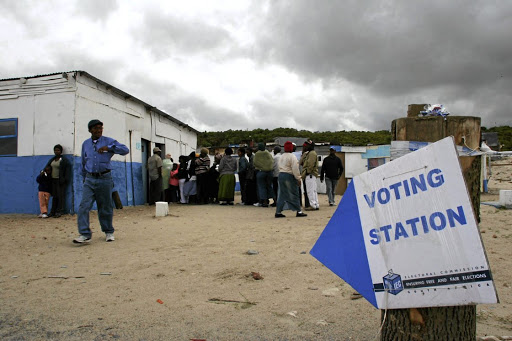 File image of people queuing to vote.