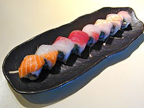 Photo: Rainbow Roll : A California Roll, rapped with different kinds of fish creating the color of the rainbow.