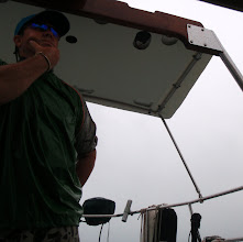 Photo: grey day at the helm in the sea of abaco