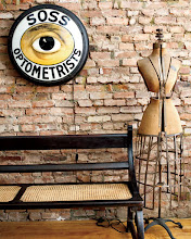 Photo: A dressmaker's form and optometrist's sign.