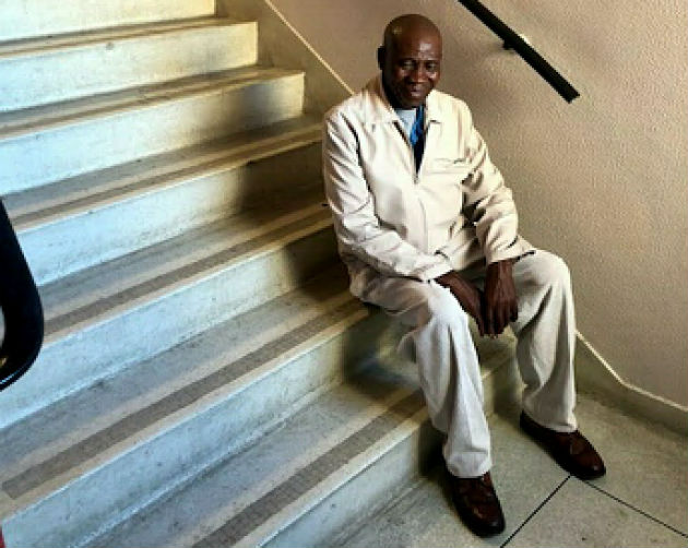 A patient rests on the 6th floor as he goes up the flight of stairs to see his doctor on the 7th floor at Provincial Hospital