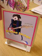 Photo: This slide and the next are part of a Year Graphics task exploring CD covers and display stands made in foam board.