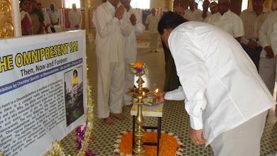 Photo: Srini ensuring the lamp is well lit!