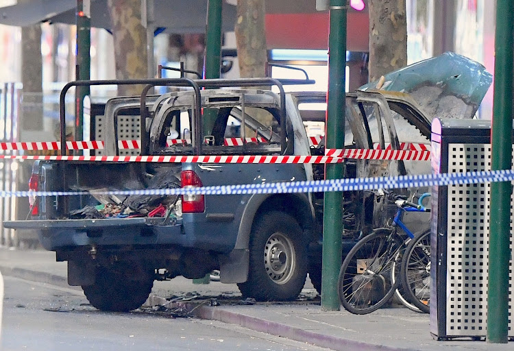 A burnt out vehicle is surrounded by police tape on Bourke Street in central Melbourne, Australia, after a terror attack on November 9 2018.
