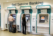 FNB self-service banking ATMs. /Jeffrey Greenberg/ Getty Images