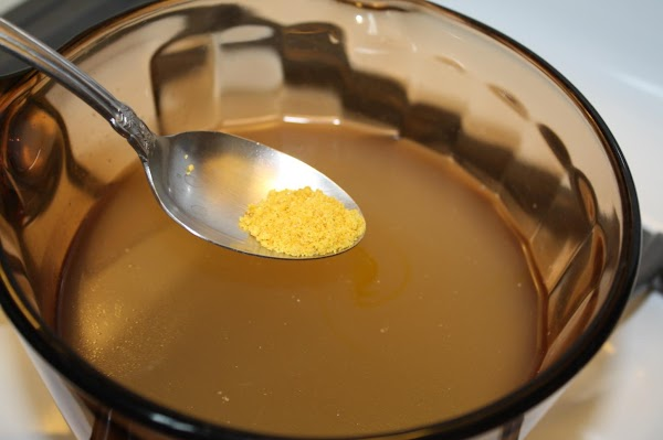 To a medium size saucepan, add chicken broth, 3-4 drops of yellow food coloring...