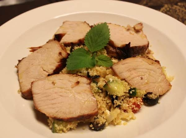 Greek Style Grilled Pork Loin Served Over Roasted Garlic And  Fresh Veggie Couscous Recipe