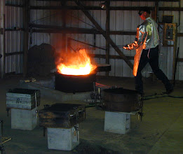 Photo: Ernie is adding the little pieces of metal to the crucible in the furnace.