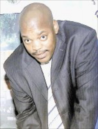 UNDER THE FLOODLIGHTS: Pat Malabela, owner of Premier Soccer League club Dynamos, who faces allegations that he got a security guard to frogmarch a prominent Limpopo businessman out of Giyani Stadium. Pic. Veli Nhlapo. 16/12/04. Sowetan.