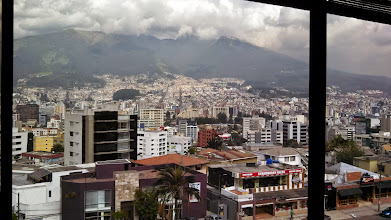Photo: Day 1: View from the 5th floor of the Hotel Quito while eating my 5 star complimentary breakfast for the day. There are so many buildings! The mountain in the back is called the Pichincha Volcano. Nothing like eating your breakfast at the bottom of an active volcano that erupted a few years ago!