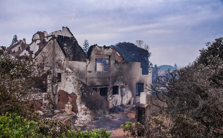 The aftermath of a fire that gutted at least 11 homes in St Francis Bay on Tuesday.