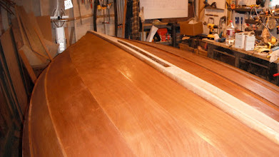 Photo: After scraping and sanding the hull, I laid on a couple of coats of CPES penetrating epoxy as a sealer.